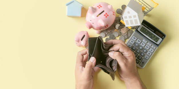 man-hand-open-empty-wallet-with-piggy-bank_34435-3359