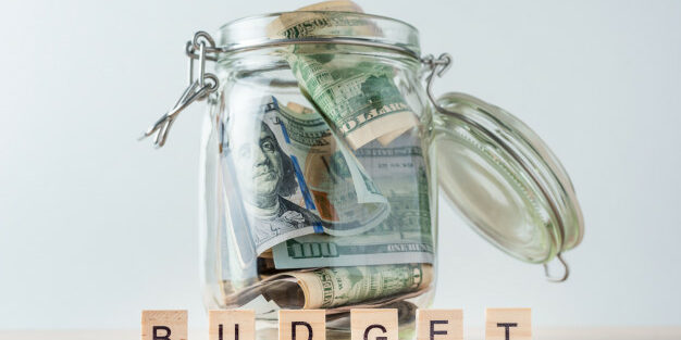 word-budget-dollar-bills-glass-jar_77190-2947